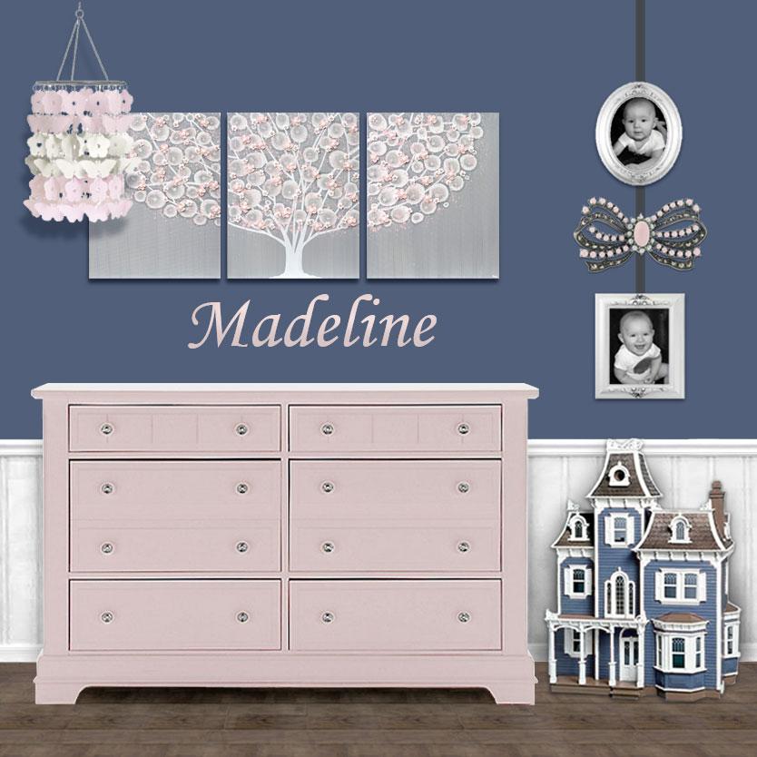 Example of a canvas art arrangement above a nursery dresser