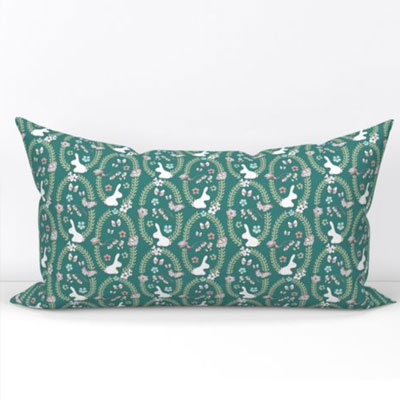 Bolster pillow in teal with bunnies