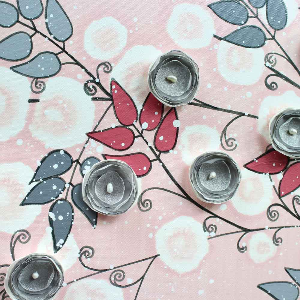 Details of nursery art pink and gray flowers