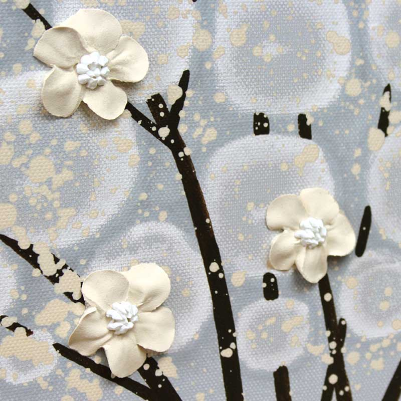 Close up of wall art gray and brown apple tree