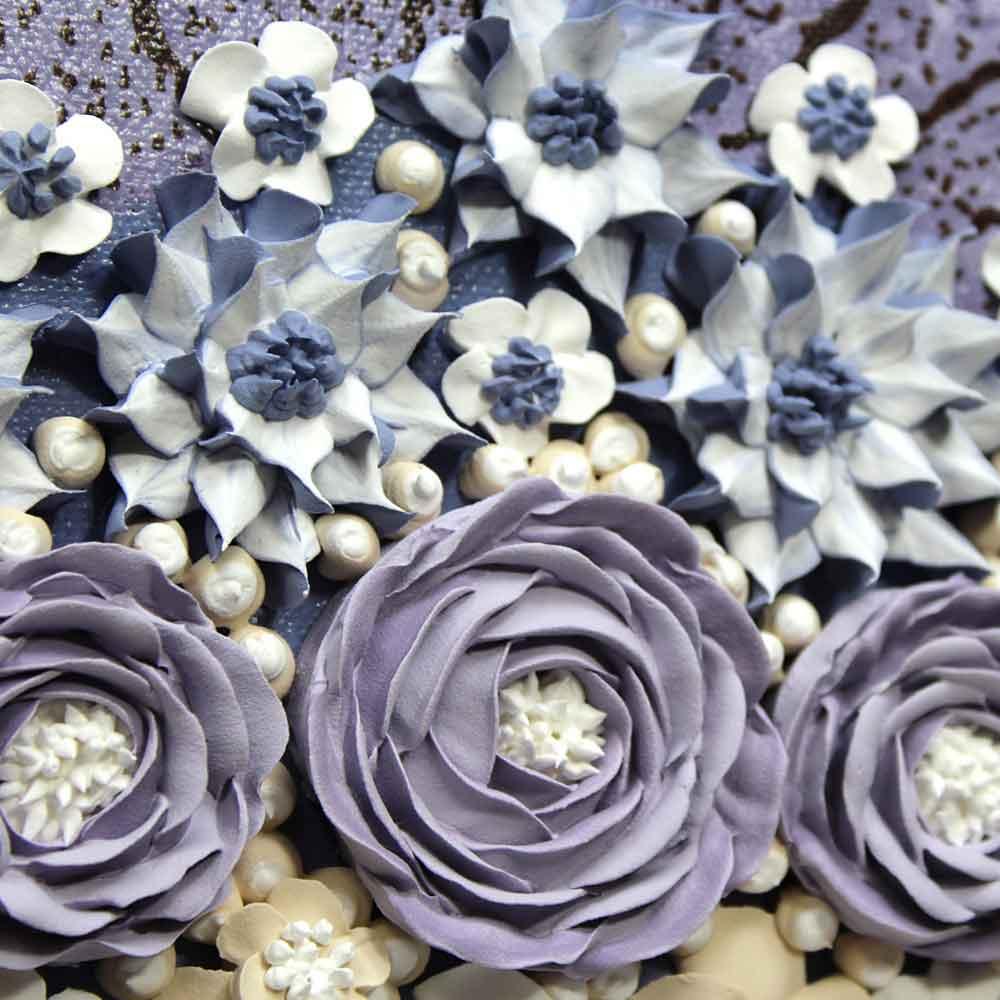 Close up of columbine nursery art grape and lavender rose bouquet