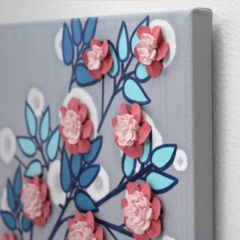 Angle view of nursery art flower branch in pink, aqua, and indigo