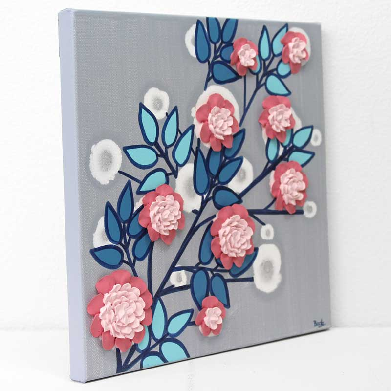 Side view of nursery art flower branch in pink, aqua, and indigo