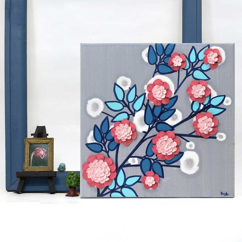 Setting of nursery art flower branch in pink, aqua, and indigo