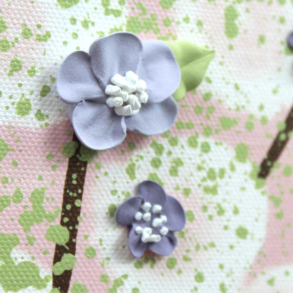 Close up of flowers on nursery art pink and purple tree