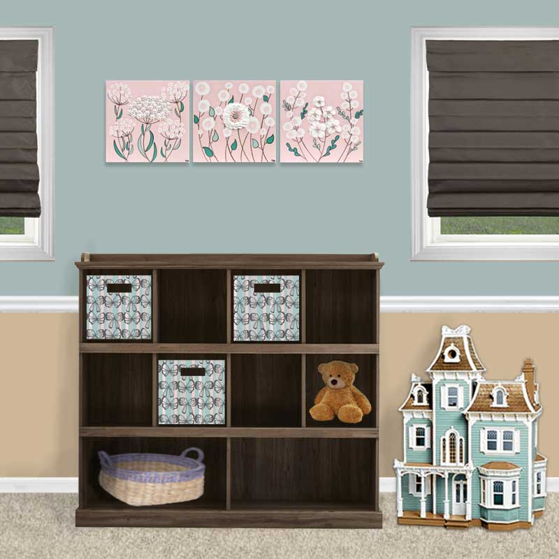 Setting view of nursery art pink and teal flowers
