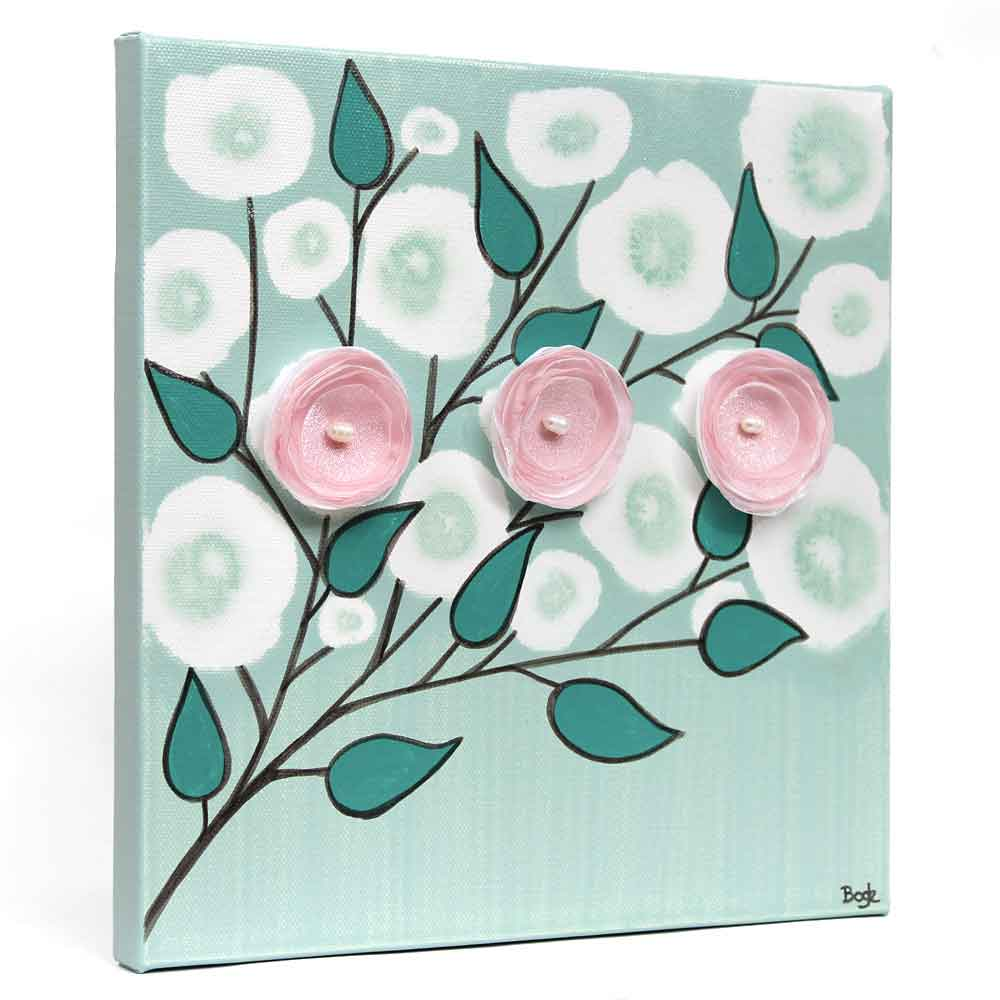 Side view of nursery art of teal and pink blossoms