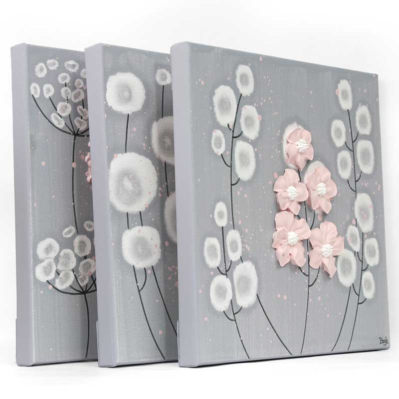 Side view of nursery canvas art gray and pink flowers