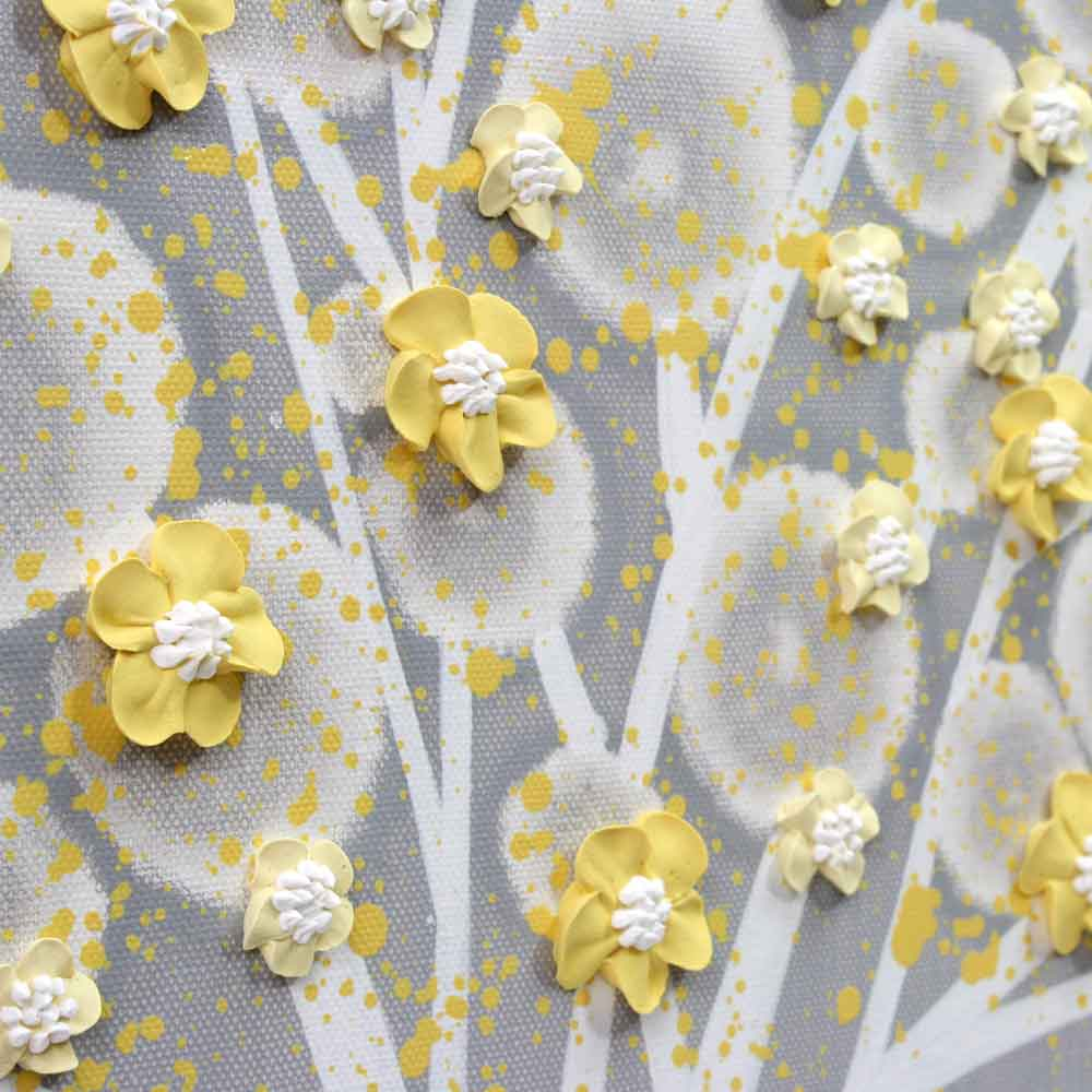 Close up of wall art gray and yellow apple tree