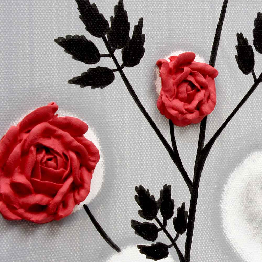Close up of wall art red rose branch