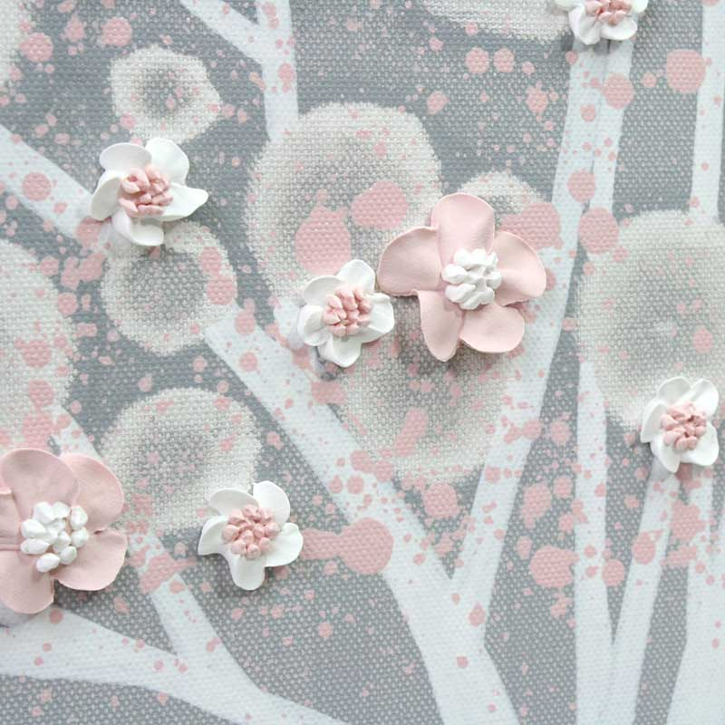 Close up of flowers on nursery art gray and pink apple tree