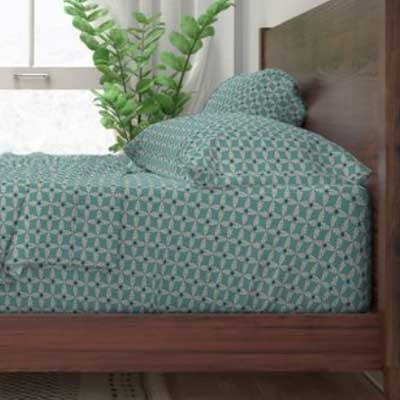 Bed sheets in art deco teal fabric