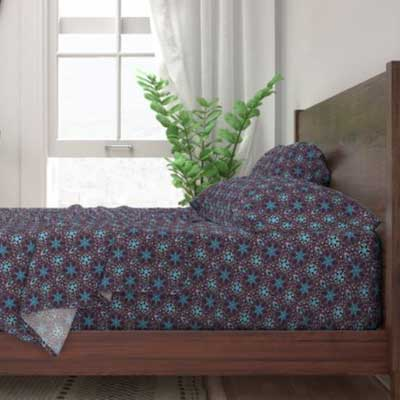 Bed sheets with purple art deco mosaic pattern