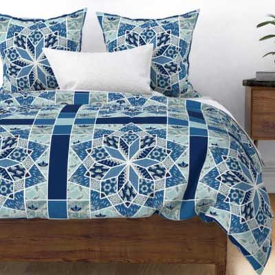 Duvet with star patchwork quilt in blue