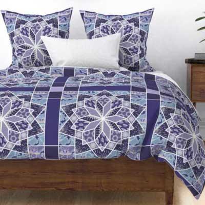 Duvet of patchwork star quilt in purple