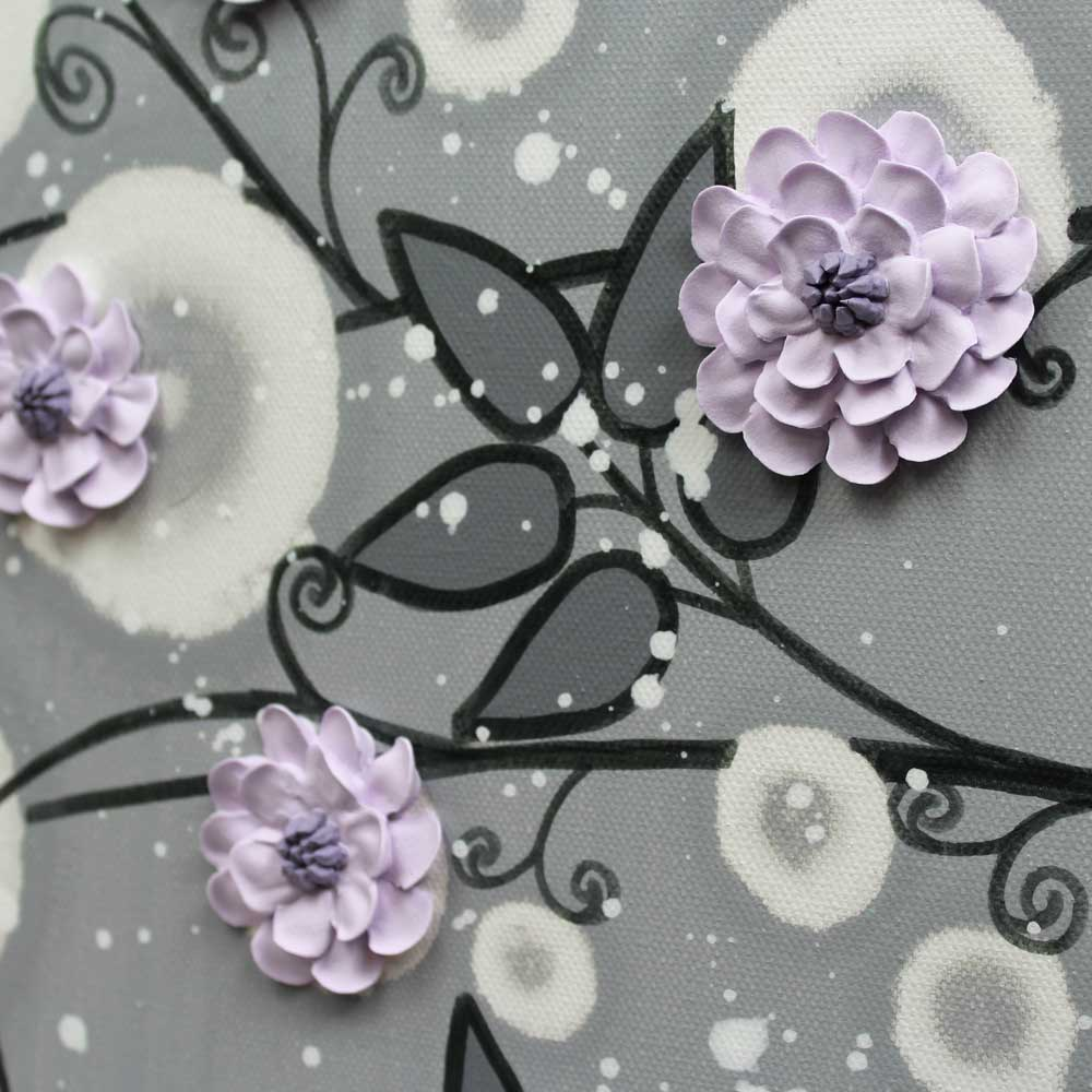 Close up of gray and lilac nursery art climbing flowers