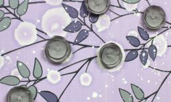 Center view of nursery art flowers in lilac an gray