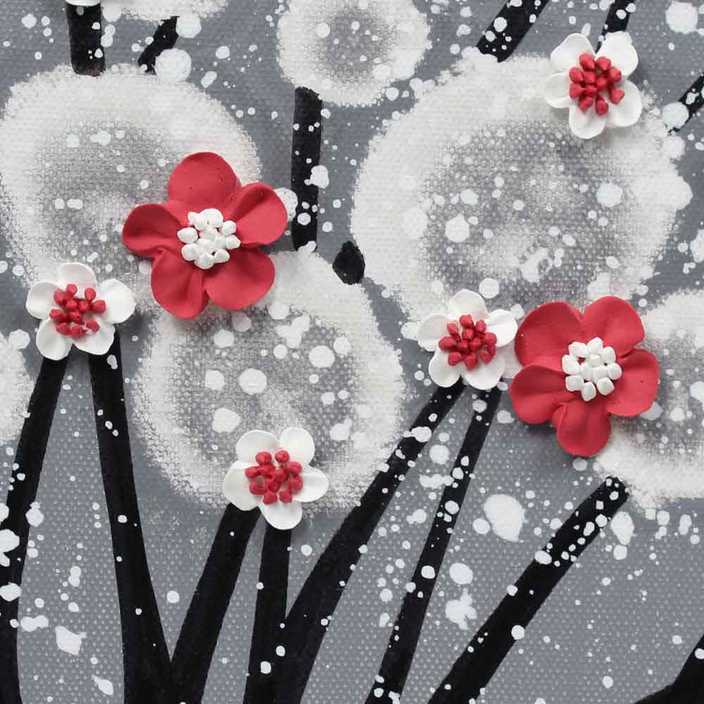 Close up of wall art feather gray and red blossom tree