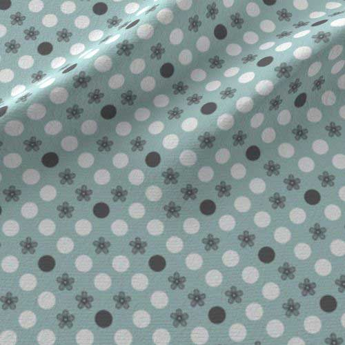 Polka dot print on fabric in aqua, gray