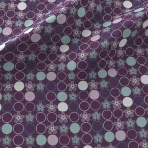 Polka dot print on fabric in purple, aqua, gray