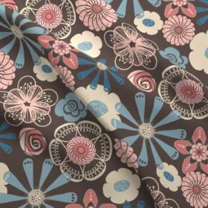 Flower print on fabric in peach, brown, blue