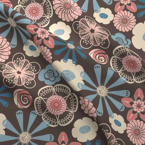 Flower print on fabric in peach, brown, blue