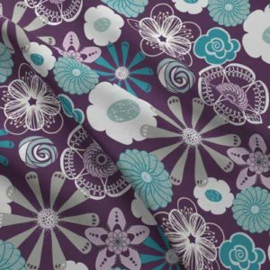 Flower print on fabric in purple, gray, aqua