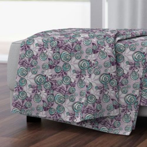 Throw blanket with teal and purple roses