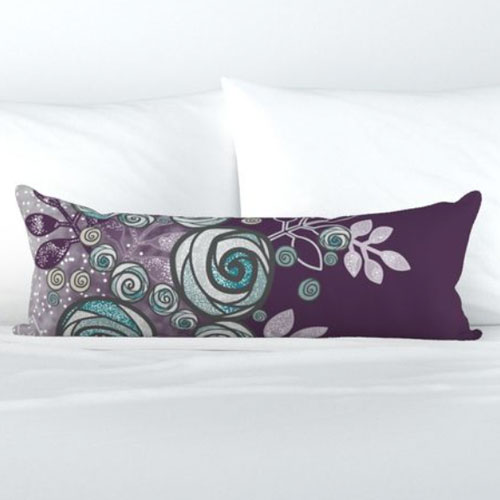 Bolster pillow with large teal and purple roses