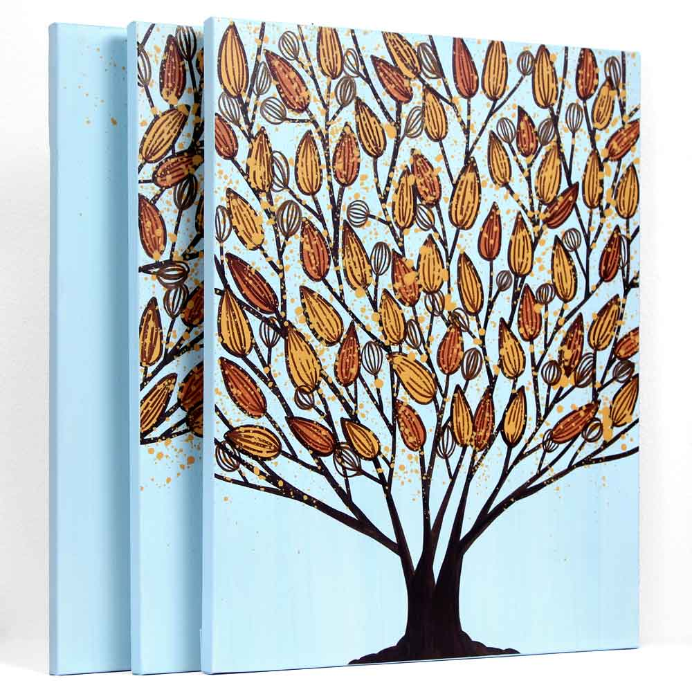 Side view of triptych wall art tree in blue and orange