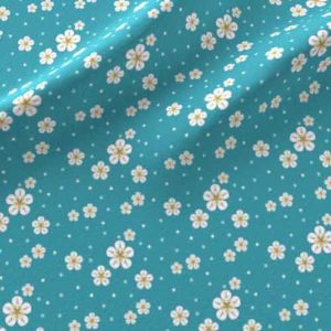 Ditzy fabric print of yellow flowers on teal