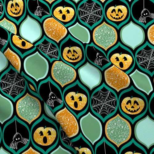 Jack-o-lantern Halloween fabric in teal, black, and orange
