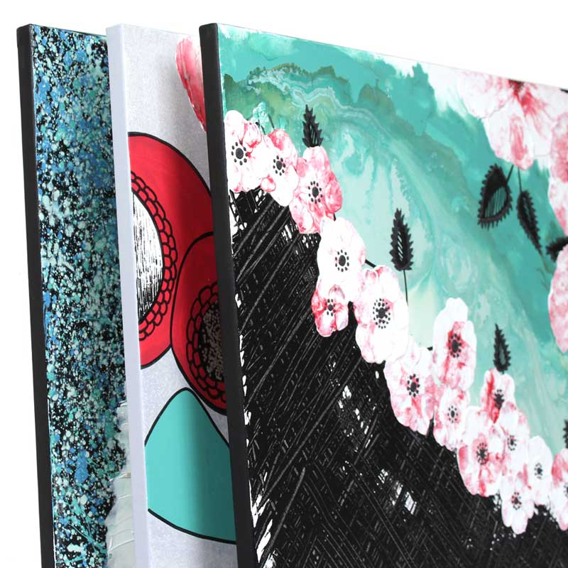 Side view of office wall art set of 3 in black, teal, and red