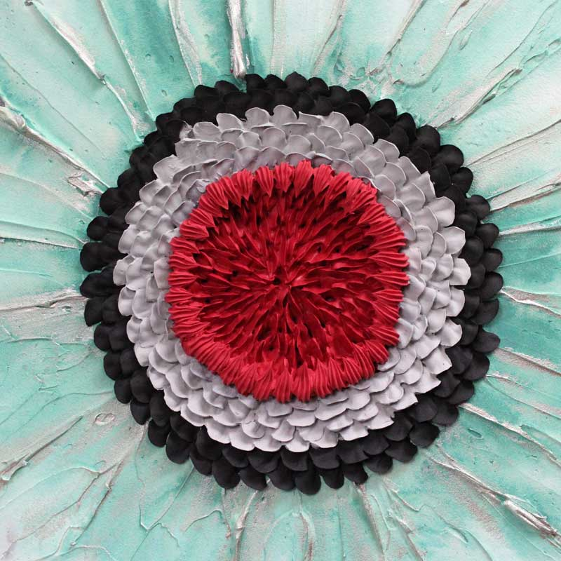 Close up of sculpted zinnia flower on office wall art set of 3 in black, teal, and red