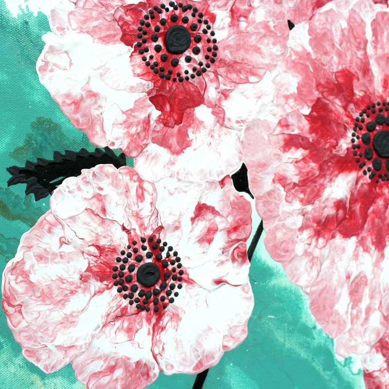 Cherry blossom details on office wall art in black, teal, and red