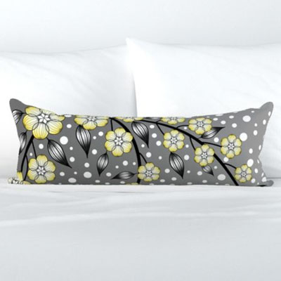 Bolster pillow of yellow and gray flowers