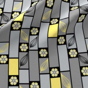Fabric print of bricks and flower in gray, black, and yellow