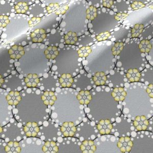 Fabric print of flower garlands and dots in yellow and gray