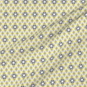 Fabric with geometric flowers in yellow and gray