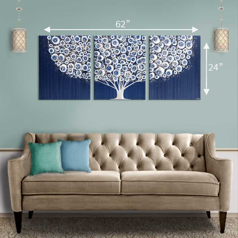 Setting of sofa for wall art of tree in indigo blue and brown gray