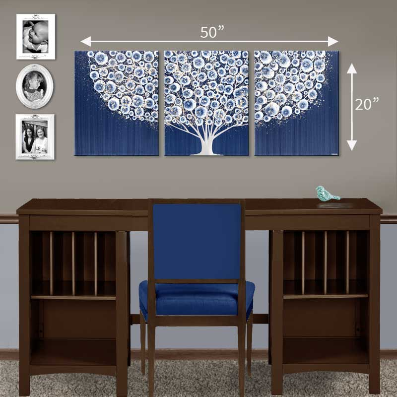 Setting of desk for wall art of tree in indigo blue and brown gray