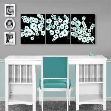 Painting of teal and black cherry blossom on canvas triptych