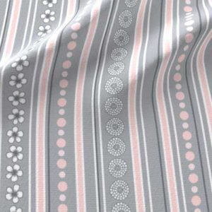 Nursery fabric stripes in pink, gray, and white with flowers