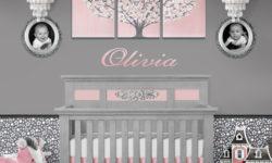 Setting with pink and gray tree wall art and polka dot wallpaper