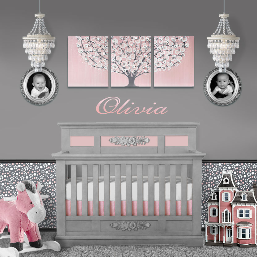 Setting with pink and gray tree wall art and polka dot wallpaper