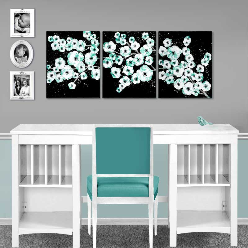 Setting view of painting of teal and black cherry blossom on canvas triptych