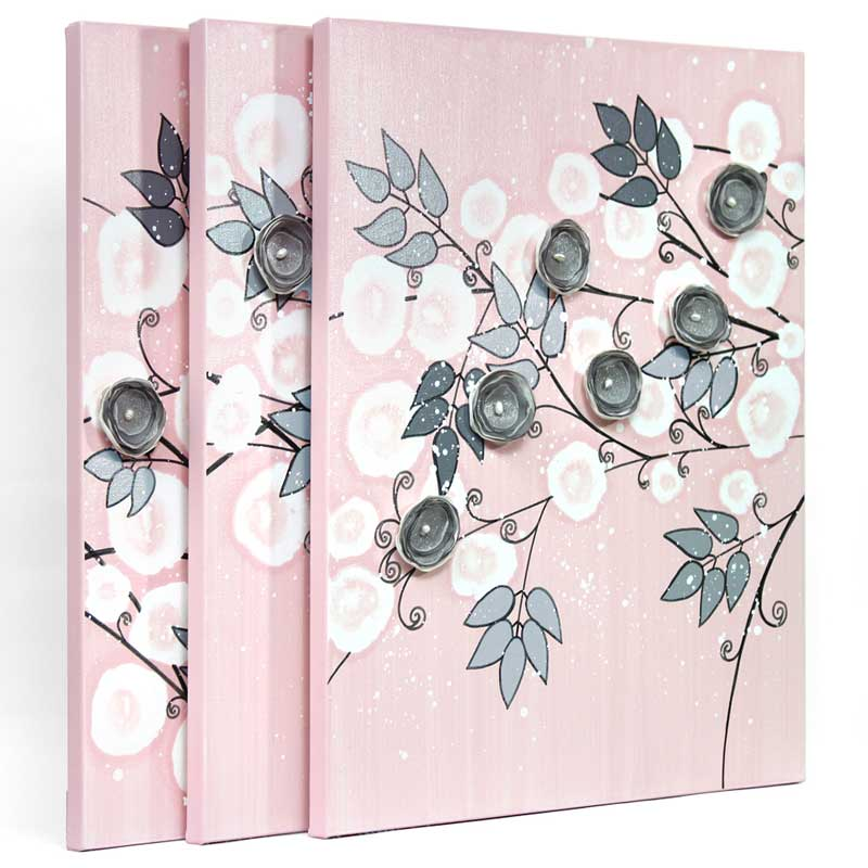 Side view of nursery wall art of pink and gray climbing flowers
