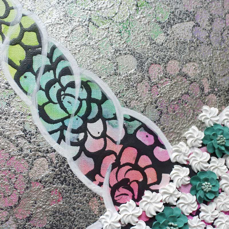 Horn close up of wall art of silver unicorn of colorful dahlias