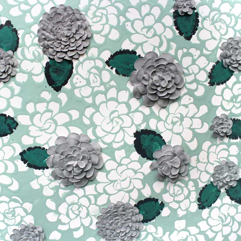 Center view of wall art of teal and gray dahlia flowers