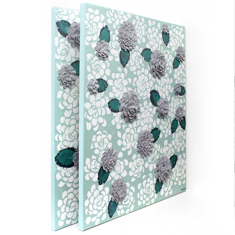 Side view of wall art of teal and gray dahlia flowers